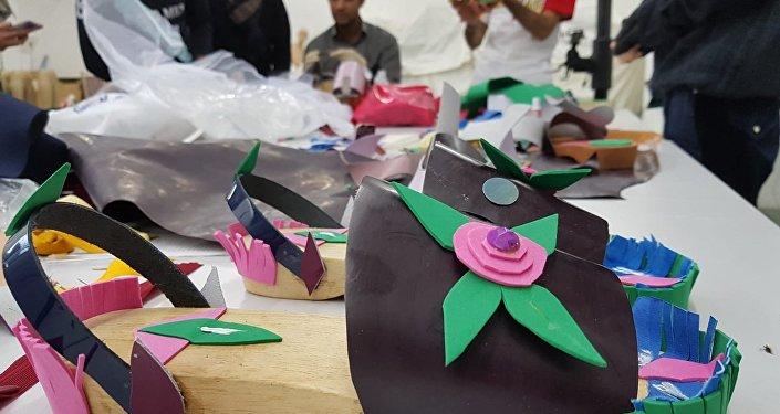 Projet Facets - cours de mode pour les réfugiés