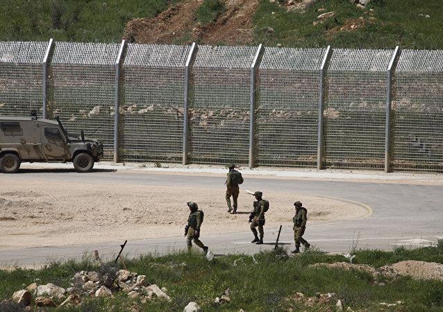 Militaires israéliens près de la frontière israélo-syrienne