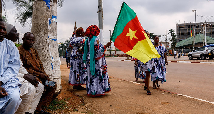 Supporters of Cameroonian President Paul Biya celebrate his re-election in Yaoundé on November 6, 2018.