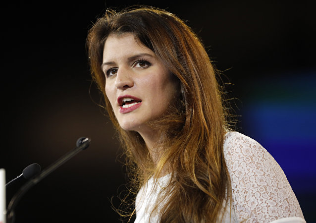 In this Nov.18, 2017 file photo, French deputy minister in charge of Equality between Women and Men Marlene Schiappa delivers a speech in Chassieu, near Lyon, central France.
