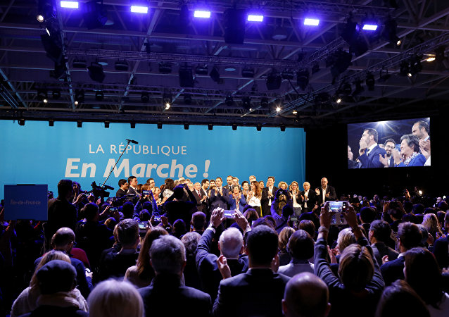 A close ally of French President Emmanuel Macron, Christophe Castaner, center, stands on the scene with his colleagues after being elected delegate general of French president's new centrist party, La Republique en Marche (The Republic on the Move, LREM), during a party convention in Chassieu, near Lyon, central France, Saturday, Nov. 18, 2017.