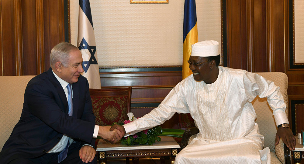 Israeli Prime Minister Benjamin Netanyahu shakes hands with Chad's President Idriss Deby, during their meeting in N'Djamena, Chad
