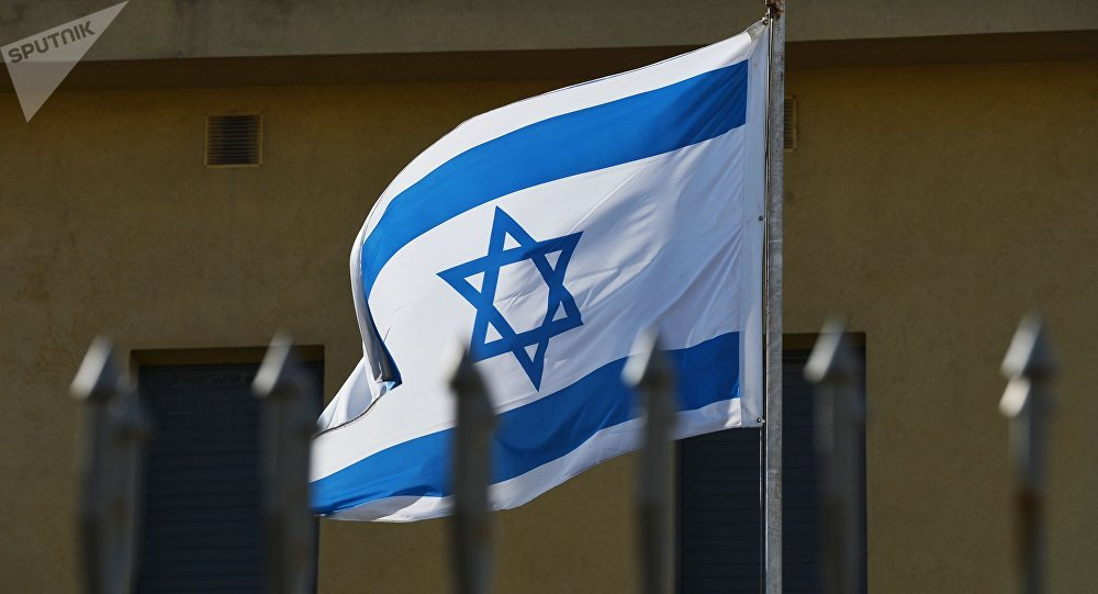 The flag on the premises of the Embassy of Israel in Moscow which has suspended its operations as the diplomats go on strike.