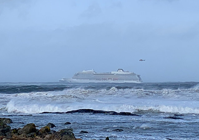 The cruise ship Viking Sky is pictured on March 23, 2019 near the west coast of Norway at Hustadvika near Romsdal. Emergency services said on March 23, 2019 they were airlifting 1,300 passengers off a cruise ship off the Norwegian coast.