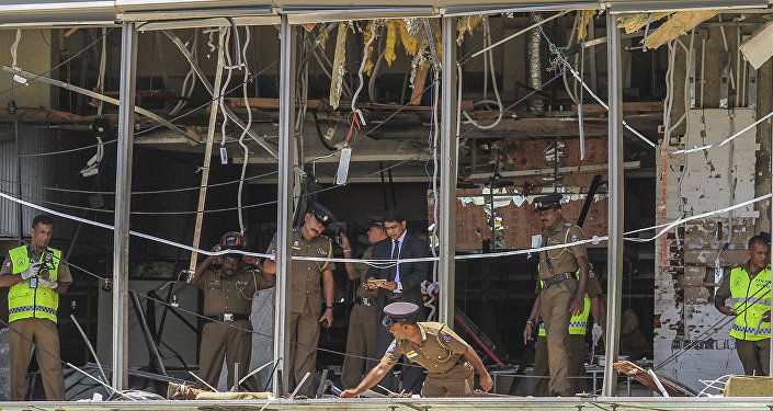 A Sri Lankan Police officer inspects a blast spot at the Shangri-la hotel in Colombo, Sri Lanka, Sunday, April 21, 2019.