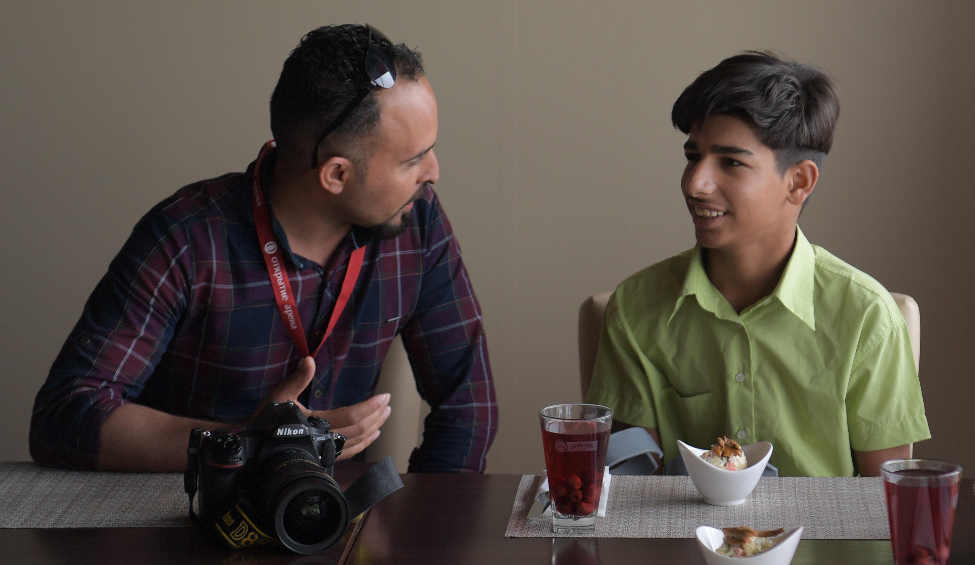 Qassim Alqadime et le photographe Tayseer Mahdi