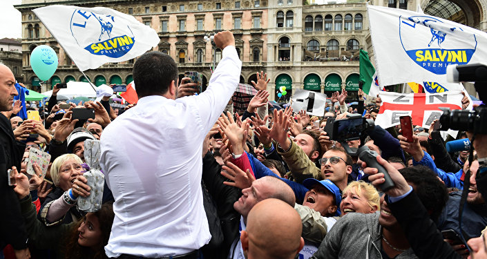 Italian Deputy Prime Minister and Interior Minister Matteo Salvini (C) greets supporters during a rally of European nationalists ahead of European elections on May 18, 2019, in Milan
