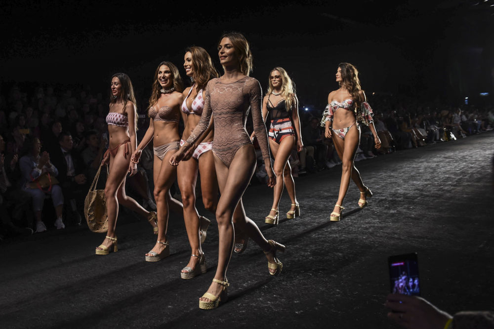 Models present creations by Colombian brand Chamela at Colombiamoda during Medellin Fashion Week in Medellin, Colombia, on July 24, 2019.