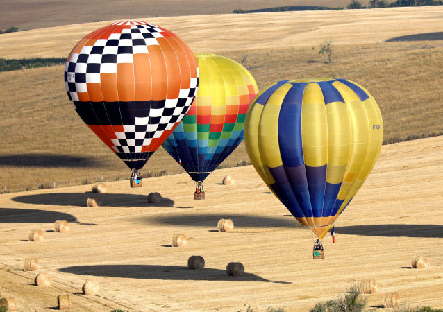 Hundreds of hot air balloons take part in the Great Line at the Mondial Air Ballons festival in Chambley, in an attempt to break the 2017 record of 456 balloons aligning in an hour during the biggest meeting in the world, in Chambley, France, July 29, 2019.