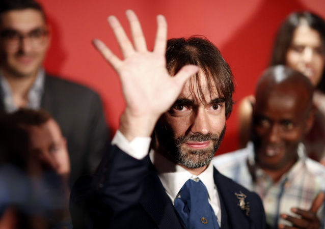 Paris mayoral dissident candidate from La Republique En Marche (LREM) political party, Cedric Villani waves after he gave a speech to announce his candidature for the upcoming mayoral elections in Paris, Wednesday, Sept. 4, 2019.