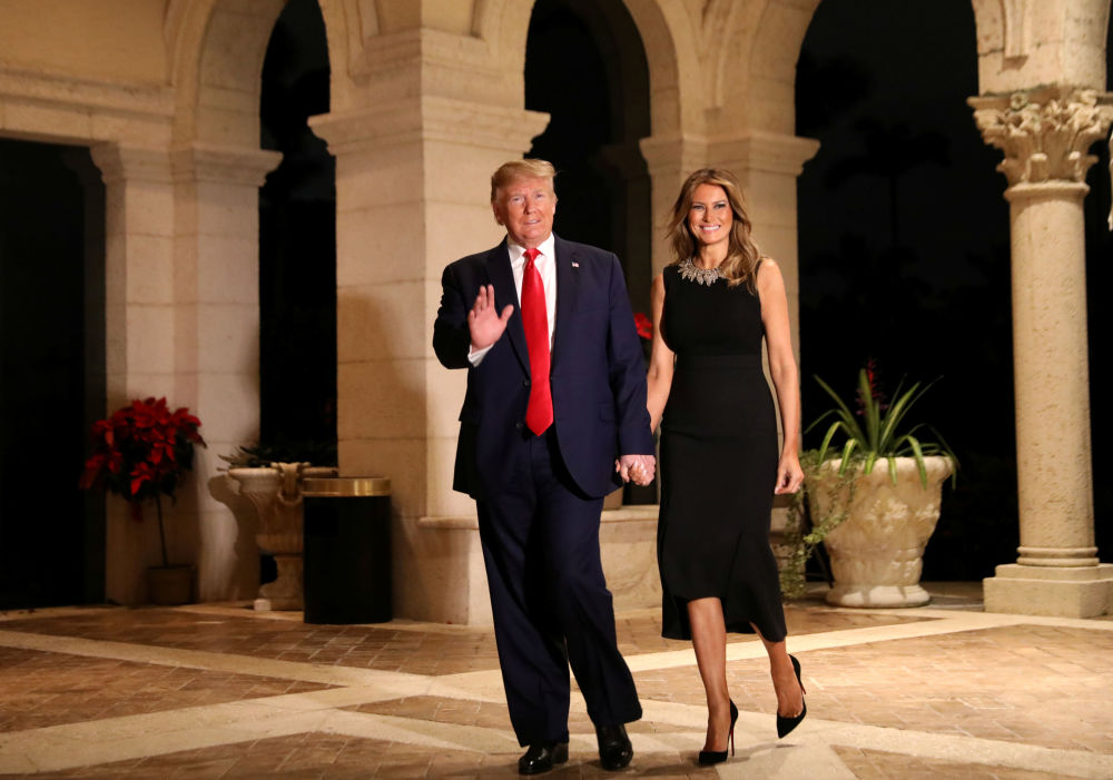 U.S. President Donald Trump and First Lady Melania Trump arrive to their Christmas Eve party at Trump's Mar-a-Lago resort in Palm Beach, Florida, U.S., December 24, 2019.