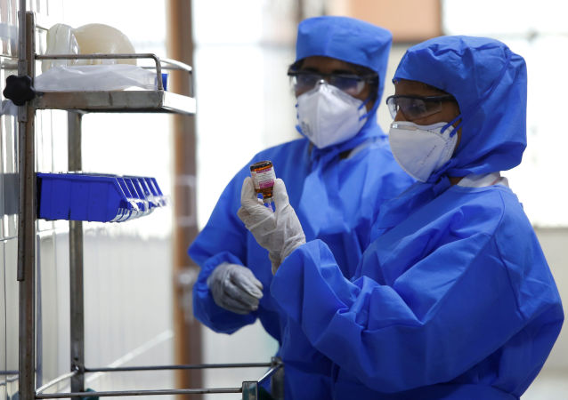 Medical staff with protective clothing are seen inside a ward specialised in receiving any person who may have been infected with coronavirus, at the Rajiv Ghandhi Government General hospital in Chennai, India, January 29, 2020.