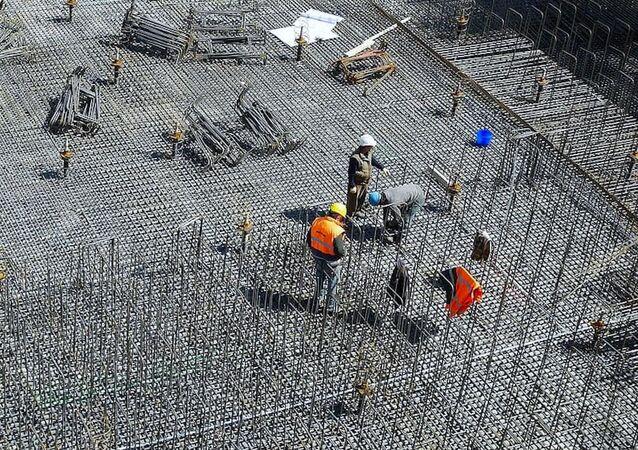 Ouvriers du bâtiment (image d'illustration)