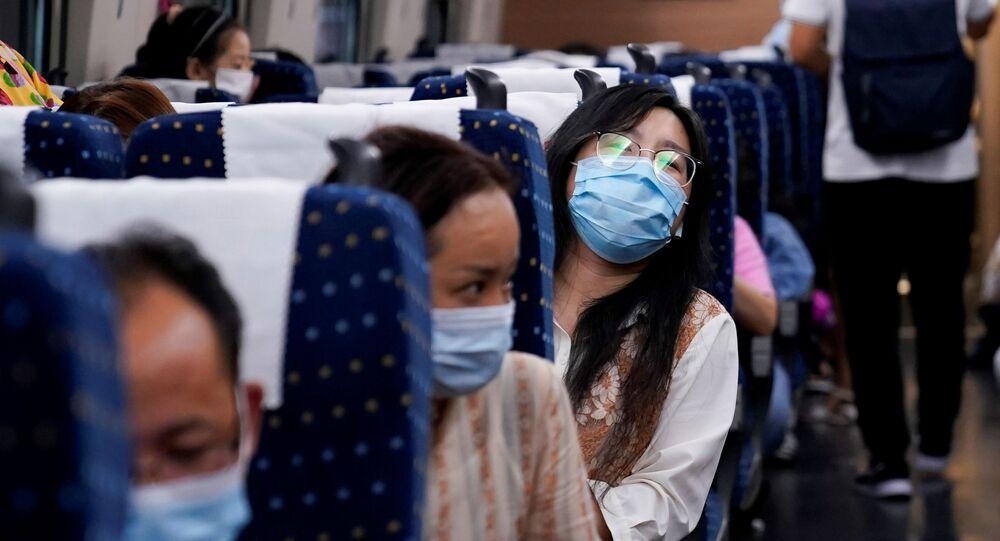 Das passagers dans un train à grande vitesse en Chine