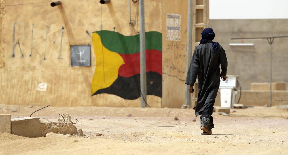 Le drapeau du MNLA peint sur le mur d'une maison au Mali