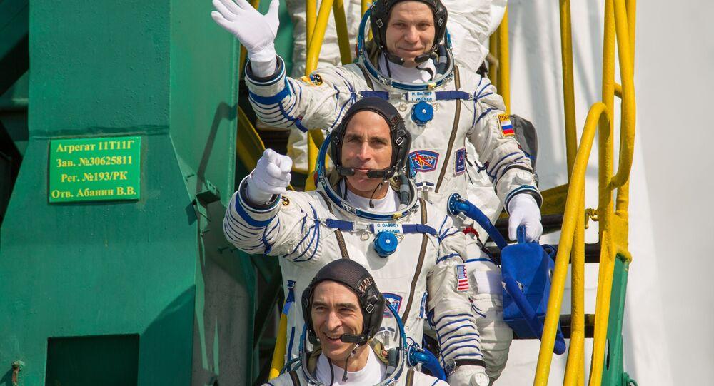 Anatoli Ivanichine, Christopher Cassidy et Ivan Vagner (de bas en haut) avant leur départ pour l'ISS (archive photo)