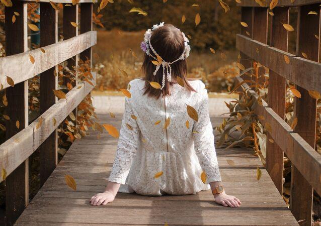 Une jeune fille (image d'illustration)
