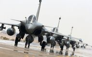 This photo released on Sunday, Sept. 27, 2015 by the French Army Communications Audiovisual office (ECPAD) shows French army Rafale fighter jets on the tarmac of an undisclosed air base as part of France's Operation Chammal launched in September 2015 in support of the US-led coalition against Islamic State group