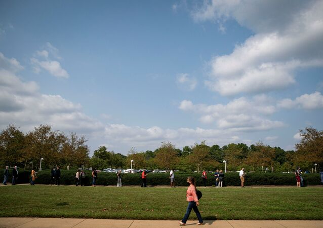 People wait in a socially distant line at an early voting site at the Fairfax County Government Center in Fairfax, Virginia, U.S., September 18, 2020.