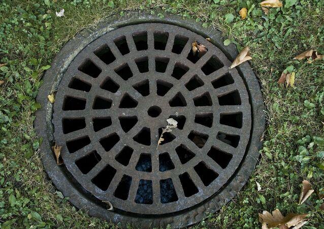 Plaque d'égout (image d'illlustration)