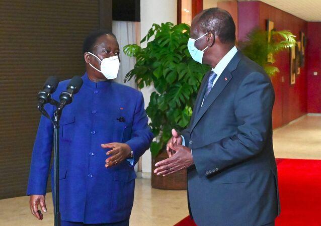 Le Président ivoirien Alassane Ouattara et le leader de l'opposition Henri Konan Bédié