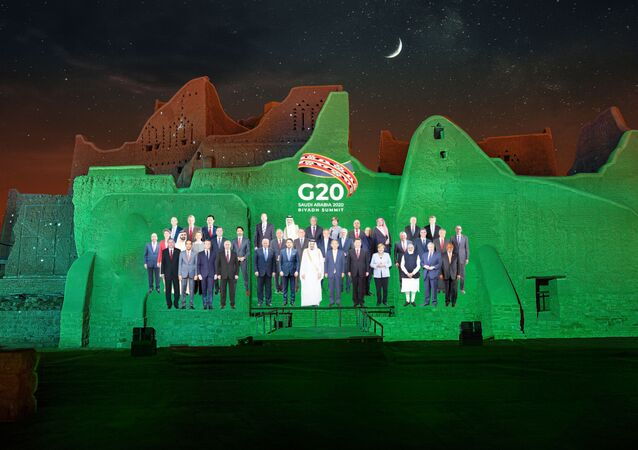 Family Photo for the annual G20 Summit World Leaders is projected onto Salwa Palace in At-Turaif, one of Saudi Arabia's UNESCO World Heritage sites, in Diriyah, Saudi Arabia, November 20, 2020.