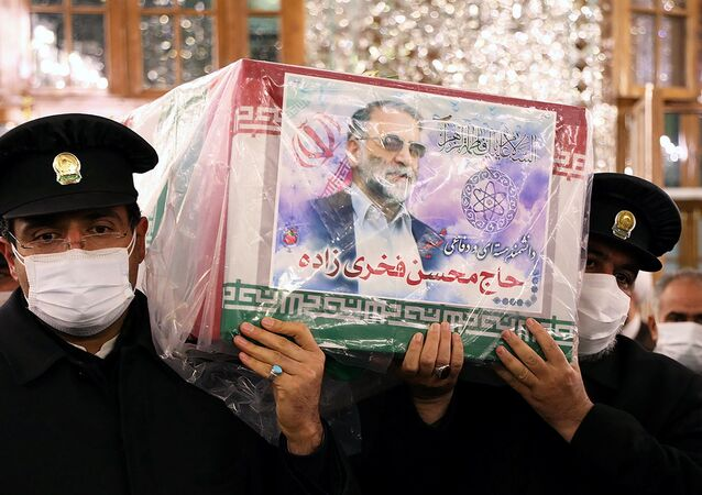 Servants of the holy shrine of Imam Reza carry the coffin of Iranian nuclear scientist Mohsen Fakhrizadeh, in Mashhad, Iran November 29, 2020