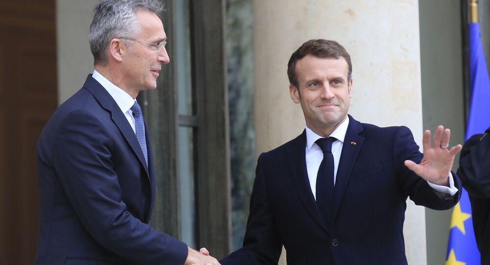 Jens Stoltenberg et Emmanuel Macron (archives)