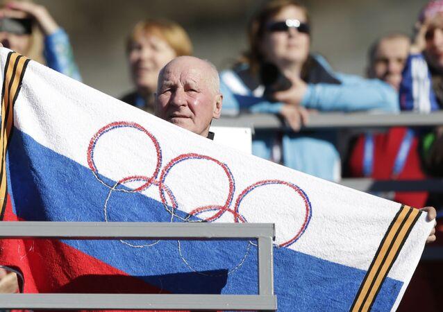 Un supporteur lors des JO avec un flag (image d'illustration)