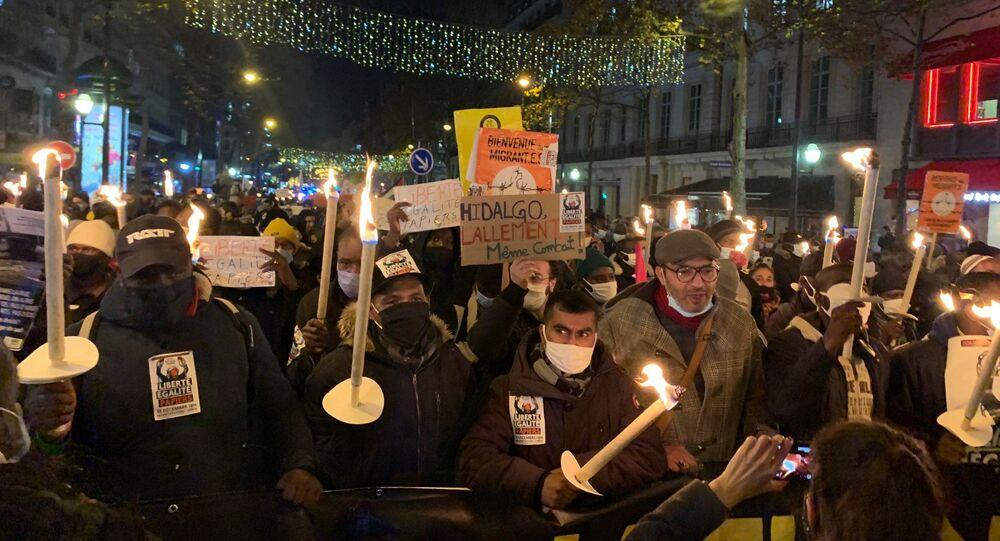 Action des sans-papiers à Paris pour la journée internationale des migrants, le 18 décembre