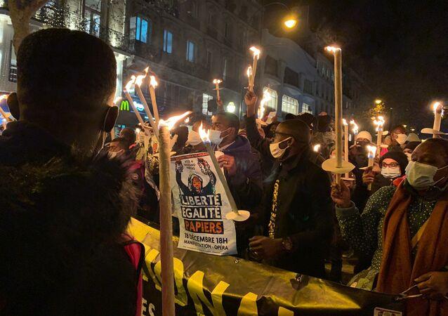Action des sans-papiers à Paris pour la journée internationale des migrants, le 18 décembre 2020