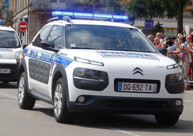 Voitures de la police municipale de Belfort lors du défilé de la Fête nationale.