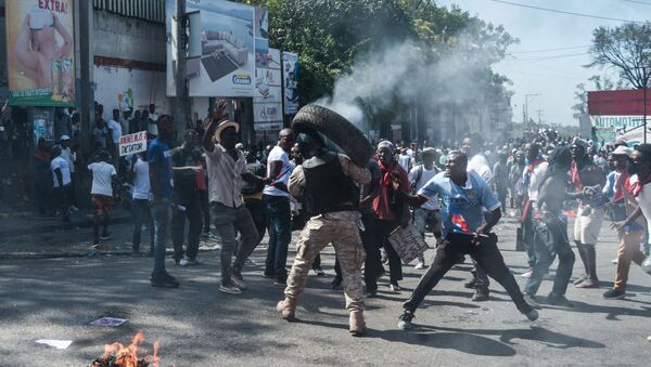 Manifestations en Haïti contre la prolongation du mandat de Jovenel Moïse, le 14 février 2021. - Sputnik France