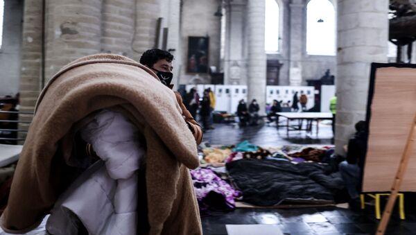Les sans-papiers occupent l'église du Beguinage à Bruxelles - Sputnik France