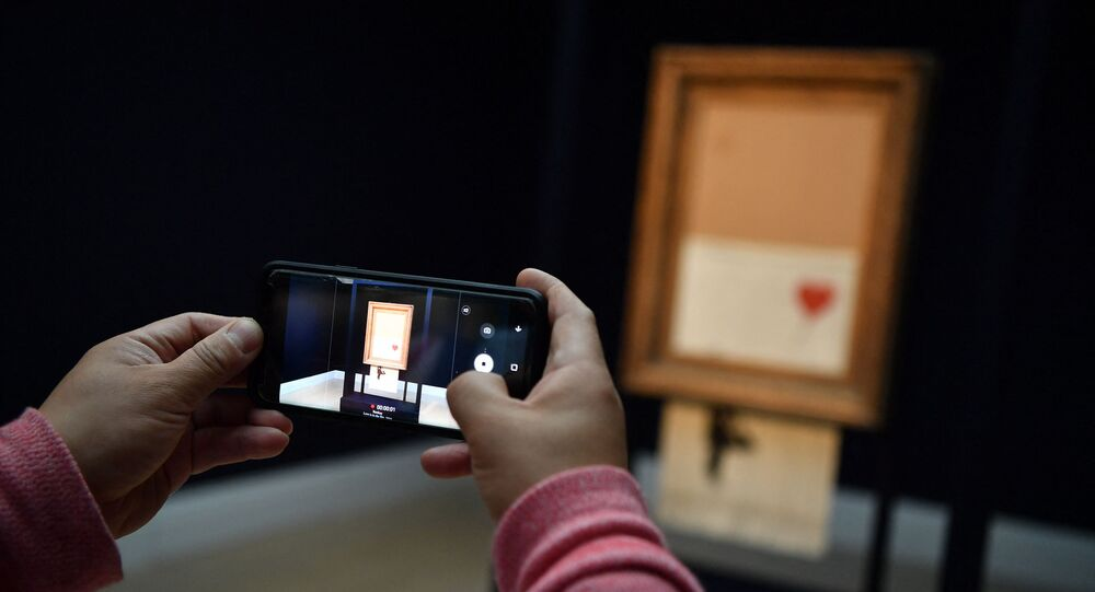 Oeuvre de Banksy Love is in the Bin