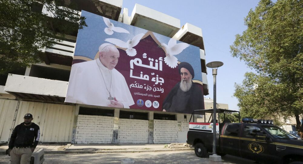 A giant billboard bears portraits of Pope Francis and Grand Ayatollah Ali Sistani in Baghdad on March 3, 2021