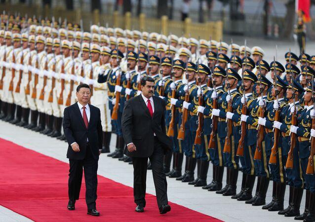 Xi Jinping et Nicolas Maduro à Pékin en 2018 (Photo by Marcelo GARCIA / Venezuelan Presidency / AFP)