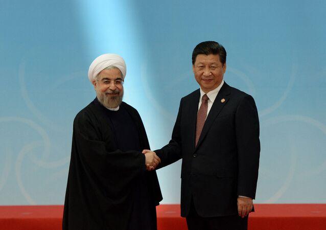 Le Président iranien Hassan Rouhani et son homologue chinois XI Jinping