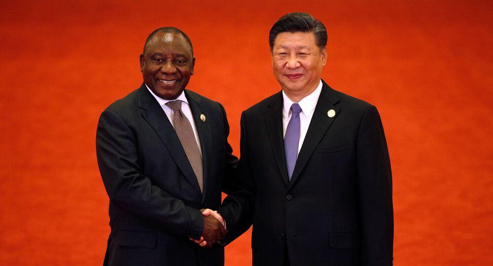 Xi Jinping et Cyril Ramaphosa en 2018 à Pékin (Photo by Andy Wong / POOL / AFP)