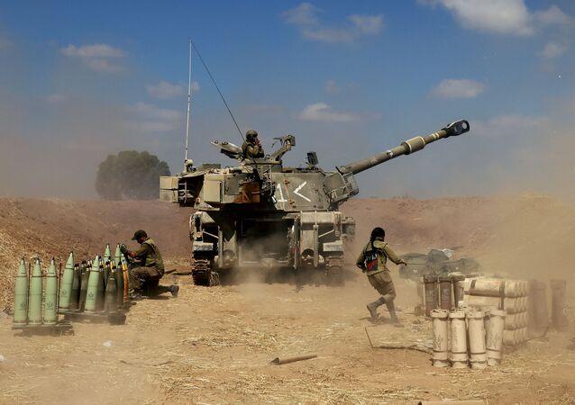 Des soldats israéliens mènent le feu contre la bande de Gaza (archive photo)
