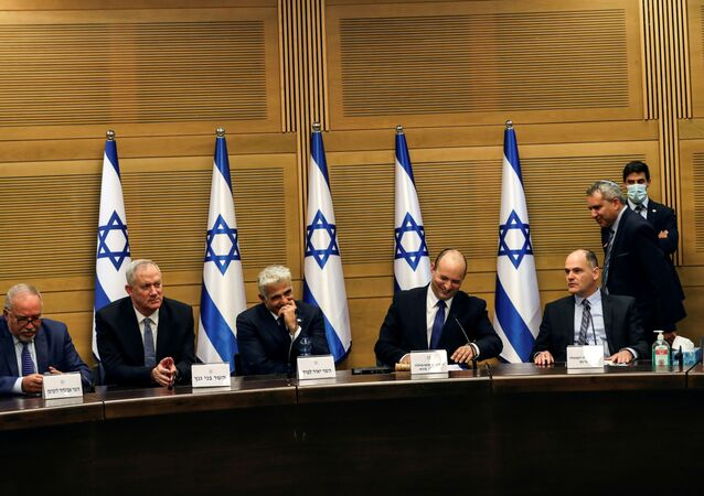Israeli Prime Minister Naftali Bennett and some of his government attend its first cabinet meeting in the Knesset, Israel's parliament, in Jerusalem June 13, 2021.