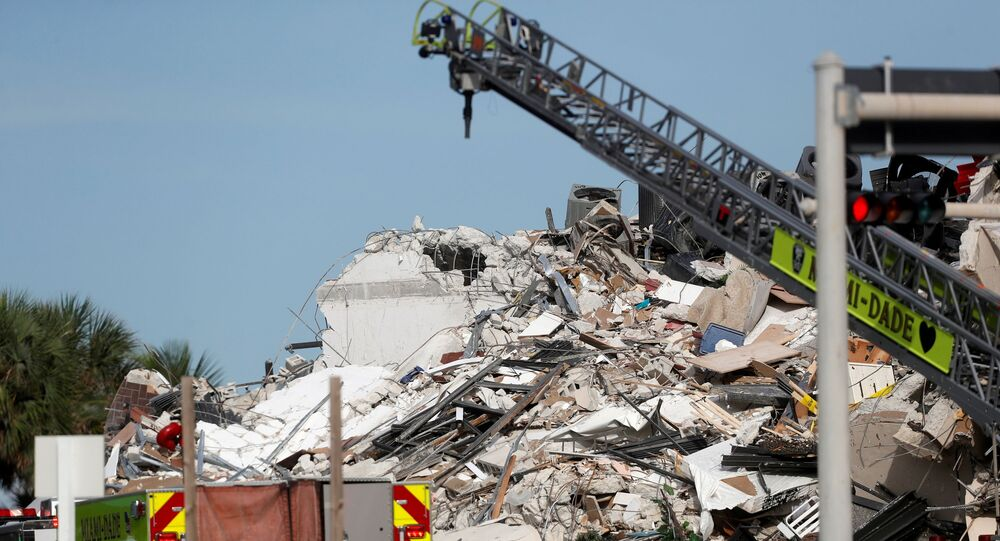 Emergency crew members search for missing residents in a partially collapsed building in Surfside, near Miami Beach, Florida, U.S., June 24, 2021.
