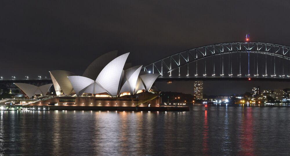 Le port de Sydney, l'Opera House et le Harbour Bridge (Photo by PETER PARKS / AFP)