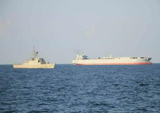 The Makran expeditionary sea base and fuel ship and Sahand frigate.