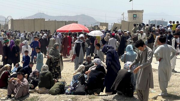 Des gens à l'aéroport de Kaboul, le 17 août 2021 - Sputnik France