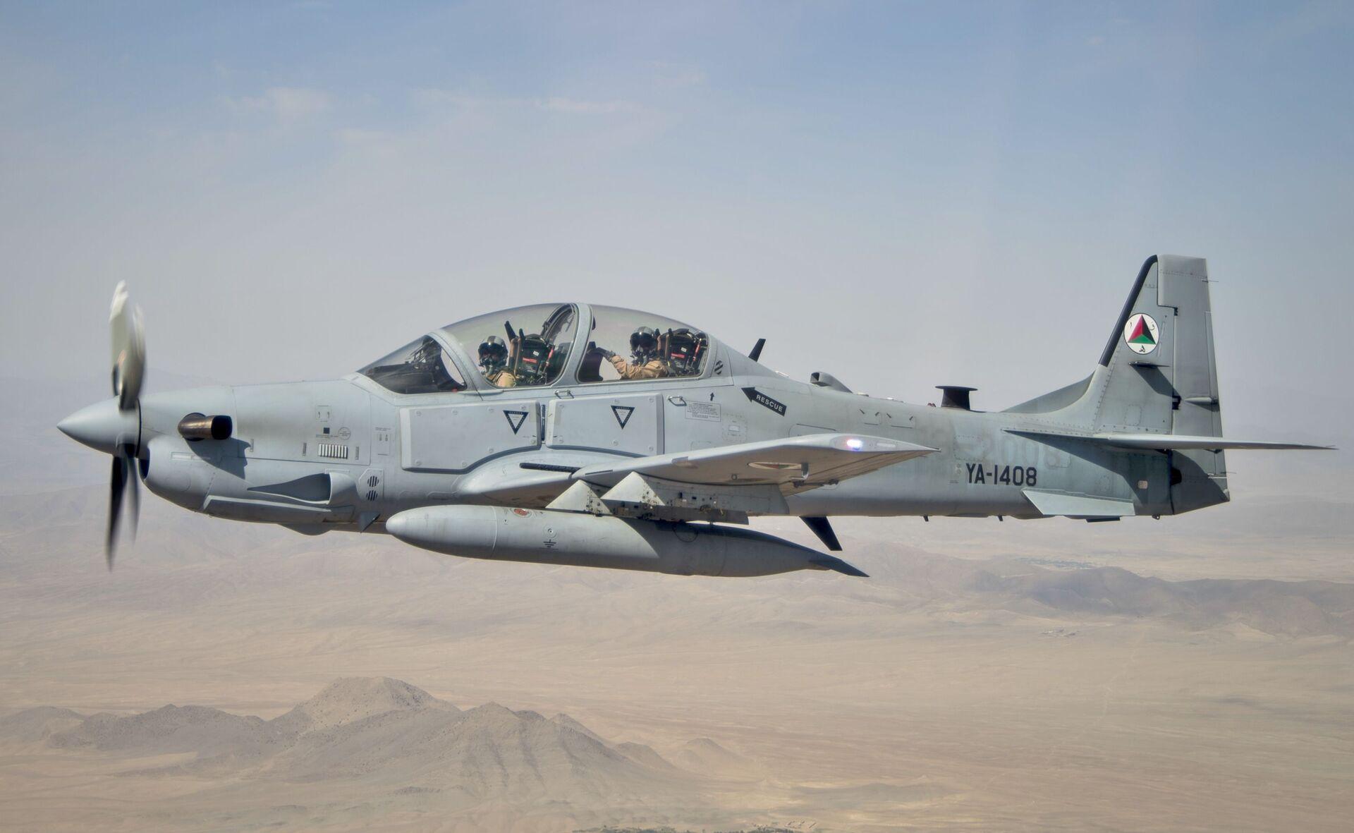 Un A-29 Super Tucano de construction américaine, ici opéré par l'armée nationale afghane en 2016. Six de ces aéronefs ont été transférés des États-Unis à l'Afghanistan au second trimestre de 2021 et ont probablement été récupérés par les Talibans* lorsque ceux-ci ont repris le pouvoir en août 2021.  - Sputnik France, 1920, 21.09.2021