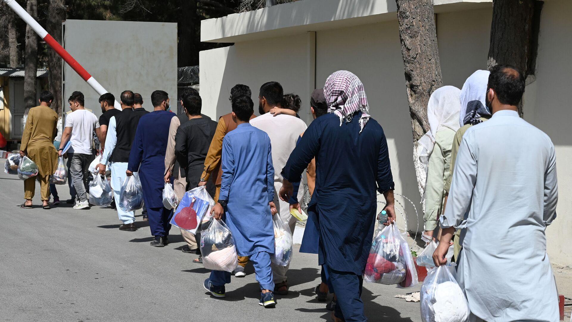 Des Afghans souhaitant quitter Kaboul, le 28 août 2021 - Sputnik France, 1920, 01.09.2021