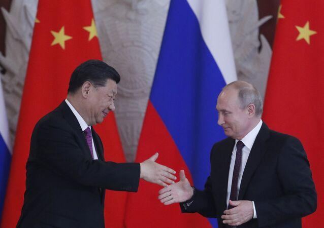 Xi Jinping et Vladimir Poutine à Moscou en 2019  (Photo de Maxim SHIPENKOV / POOL / AFP)
