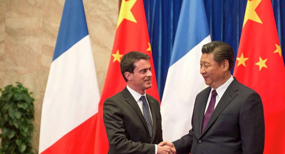 Premier ministre de France Manuel Valls  avec le président chinois Xi Jinping