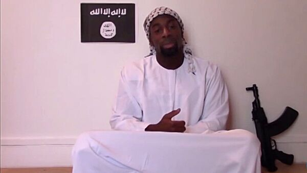 Amedy Coulibaly, one of the three gunmen behind the worst militant attacks in France for decades, declares his allegiance in an unknown location to the Islamic State and urges French Muslims to follow his example, in this still image taken from video January 11, 2015 - Sputnik France